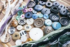 Sewing accessories: buttons and yarns.  Stock Photo