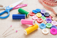 Sewing accessories on fabric Royalty Free Stock Photos