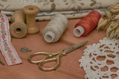 Sewing utensils and sewing fabrics stock images