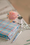 Sewing accessories and fabric. Sewing accessories and scott fabric Stock Image