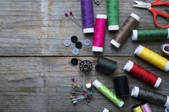 Sewing accessories and fabric on wooden table Royalty Free Stock Photos