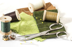 Sewing accessories in green and brown Royalty Free Stock Images