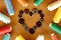 Sewing accessories with heart of buttons Royalty Free Stock Photography