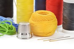 Sewing accessories. Needles and threads. Stock Image