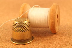 Sewing accessories. Old spool of thread and thimble Royalty Free Stock Image