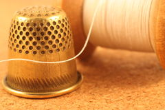 Sewing accessories. Old spool of thread and thimble Royalty Free Stock Photos