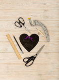 Sewing accessories of purple color and heart with an inscription Royalty Free Stock Photos