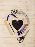 Sewing accessories of purple color and heart with an inscription Stock Images