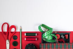 Sewing accessories in red and green colors Royalty Free Stock Photography