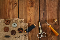 Sewing accessories: scissors, thimble, thread, awl, buttons Stock Image