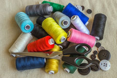 Sewing accessories. Spools of different color thread, scissors, Stock Photos