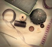 Sewing accessories on table. In old stile Royalty Free Stock Photos
