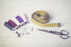 Sewing accessories. On a wooden table Stock Photos