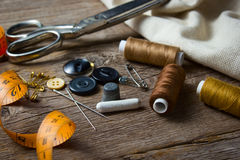 Sewing accessories on wooden table Stock Images