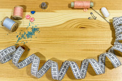 Sewing accessories on a wooden table. Small business. Income hobby. Royalty Free Stock Images