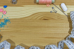 Sewing accessories on a wooden table. Small business. Income hobby. Stock Image