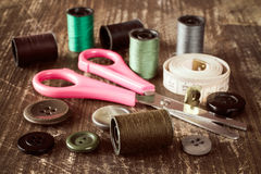 Sewing accessories on wooden table Stock Photos