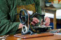 Sewing with an antique machine Royalty Free Stock Images