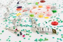 Sewing background: buttons, ruler, needles. Sewing background: buttons, bobbins, ruler, needles and beads Royalty Free Stock Photo