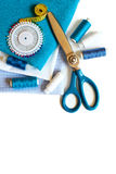 Sewing background with color threads, meter, pins and scissors Stock Photos