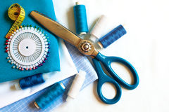 Sewing background with color threads, meter, pins and scissors Stock Image