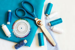 Sewing background with color threads, meter, pins and scissors Stock Images
