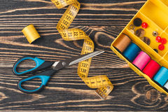 Sewing background with color threads, meter and scissors Royalty Free Stock Photos