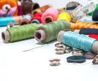 Sewing_background. Colorful threads on white painted wooden background with space for your text Royalty Free Stock Images