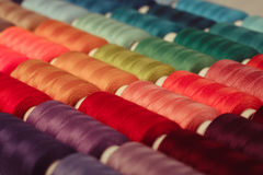 The sewing background. The sewing threads multicolored background close up Stock Images