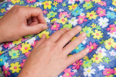 Sewing Brightly Coloured Floral Dress Royalty Free Stock Photos