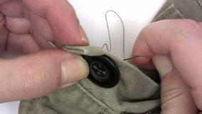 Sewing A Button stock video