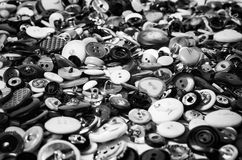 Sewing buttons in black and white. Many sewing buttons in black and white stacked Royalty Free Stock Image