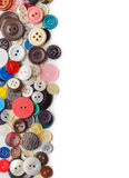 Sewing buttons border. Isolated on white background royalty free stock images