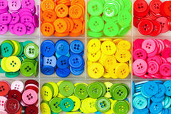 Sewing buttons in a box Royalty Free Stock Images