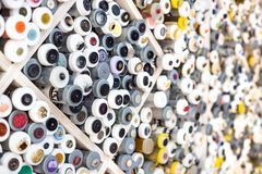 Sewing buttons on display in a fabric shop. stock photos