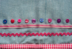 Sewing buttons fabric background Stock Images