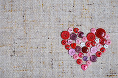 Sewing buttons in a heart shape Royalty Free Stock Photography