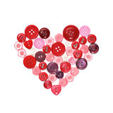 Sewing buttons in a heart shape Stock Photography