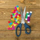 Sewing buttons and scissors Stock Photography