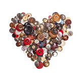 Sewing buttons in shape of heart Royalty Free Stock Images