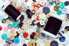 Sewing buttons and Thread. Collection of vintage sewing buttons and black thread Stock Images