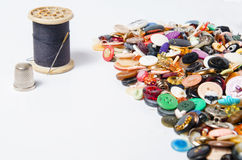 Sewing buttons and thread Royalty Free Stock Photo