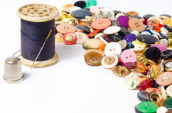 Sewing buttons and thread Royalty Free Stock Images