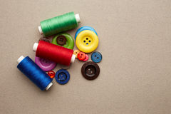 Sewing buttons and threads Royalty Free Stock Images
