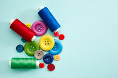 Sewing buttons and threads Royalty Free Stock Image
