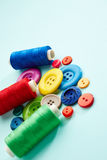 Sewing buttons and threads Royalty Free Stock Photo