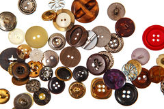 Sewing buttons on white Stock Image