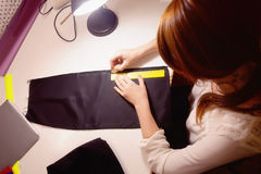 Sewing Chalk marking on Black fabric and measuring tape Stock Photos