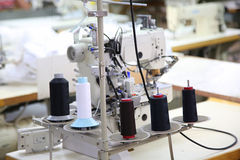 Sewing company, equipment and materials Stock Photo