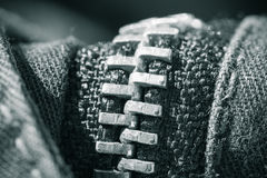 Sewing concept zipped zipper close up on black jeans in black and white Royalty Free Stock Photos